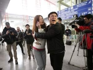 Woman believed to be relative of passenger of Malaysia Airlines flight cries