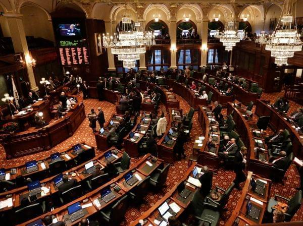 Lawmakers work toward passing pension legislation while on the House floor during session at the Illinois State Capitol Tuesday, Dec. 3, 2013 in Springfield Ill.