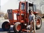 Chip Petrea stands near a modified tractor after his accident.