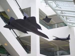Suspended from the ceiling of the CIA's headquarters in Virginia are reminders of intelligence history: three models of the U-2, A-12, and D-21 Drone. These models are exact replicas at one-sixth scale of the real planes. All three had photograp