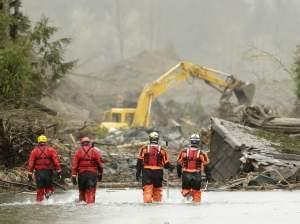 Searchers approach the site of the mudslide in Oso, Washington.