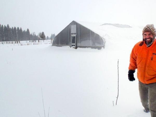 Karl Sutton leaves his mobile greenhouse in Montana. He sells spinach as part of a farmers co-op, and likes that non-profit business model for his health insurance, too.