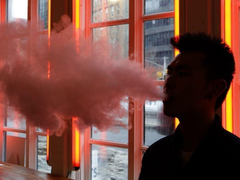 "In this Feb. 20, 2014 photo, a patron exhales vapor from an e-cigarette at the Henley Vaporium in New York. The proprietors are peddling e-cigarettes to ""vapers"" in a growing movement that now includes celebrity fans and YouTube gurus, onli"