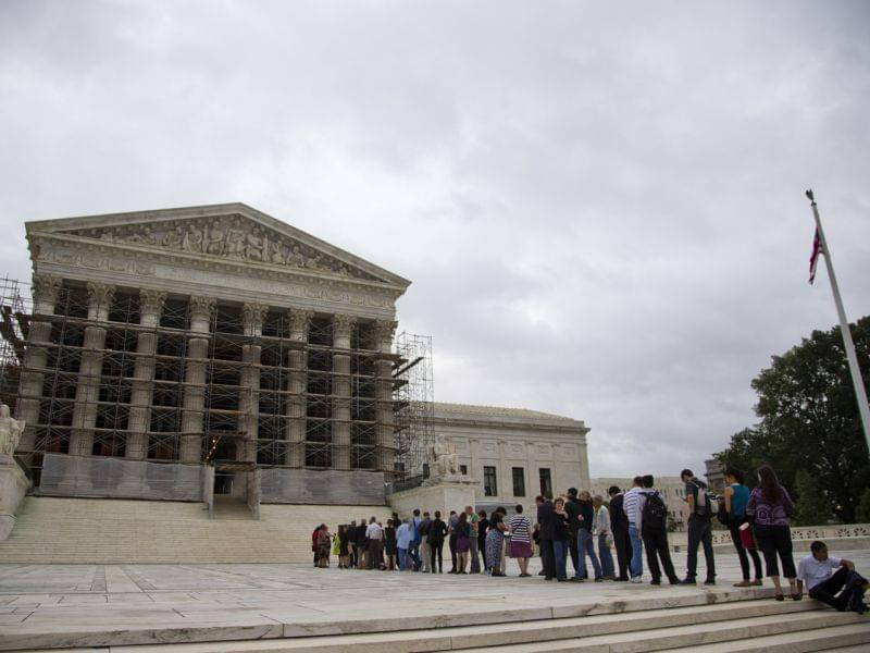 People wait in line for the beginning of the Supreme Court 2013-2014 opening term in Washington, on Oct. 7, 2013. They heard the first major case on campaign contribution limits since the landmark 2010 Citizens United.