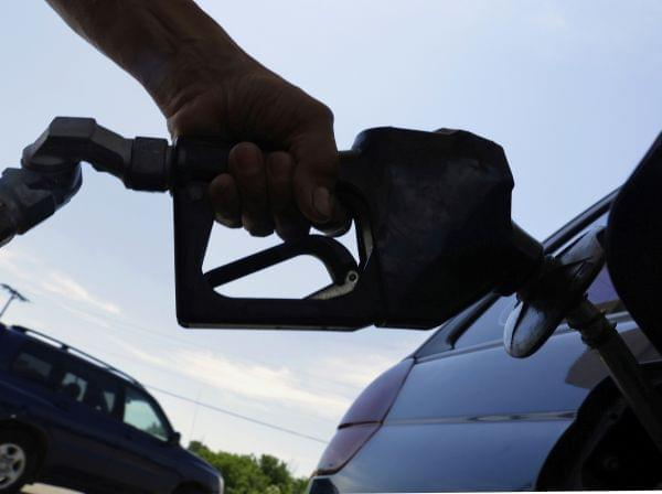In this June 11, 2013, file photo, a motorist puts fuel in his car's gas tank at a service station in Springfield, Ill.