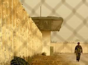 An Iraqi security officer patrols the grounds at Baghdad Central Prison in Abu Ghraib, in 2009.
