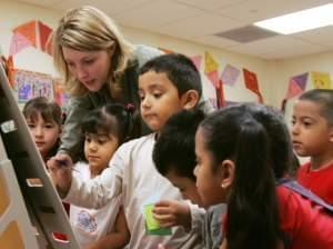 Denise Wiktor works with preschool students at the Shiloh School in downtown Waukegan, Ill., Tuesday, April 18, 2006.