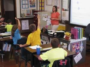 In this Wednesday, Sept. 18, 2013 photo, Shelly Ellis teaches fourth-grade students at Bement Elementary School in Bement, Ill.