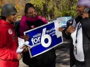 Karess, Sam and volunteer on Election Day.