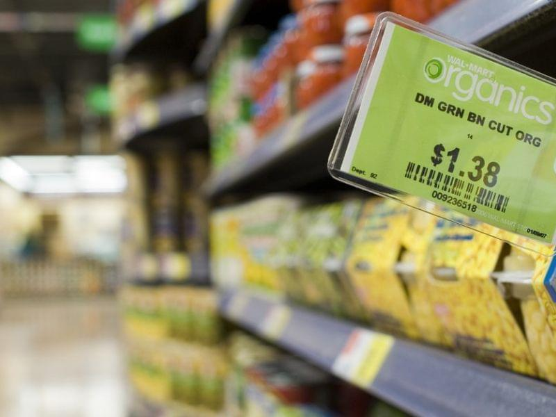 Wal-Mart is promising to drive down the prices of organic food by bringing in a new company, WildOats, to deliver a whole range of additional products.