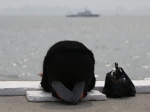 A prayer for the missing and dead: Family members and friends have gathered in the port city of Jindo, South Korea, as the search continues for the scores of passengers still missing after last Wednesday's ferry disaster. At the water's edg