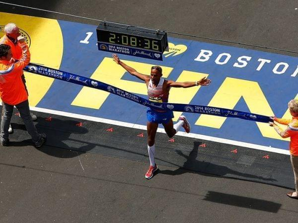 American Meb Keflezighi crosses the finish line, winning the Boston Marathon