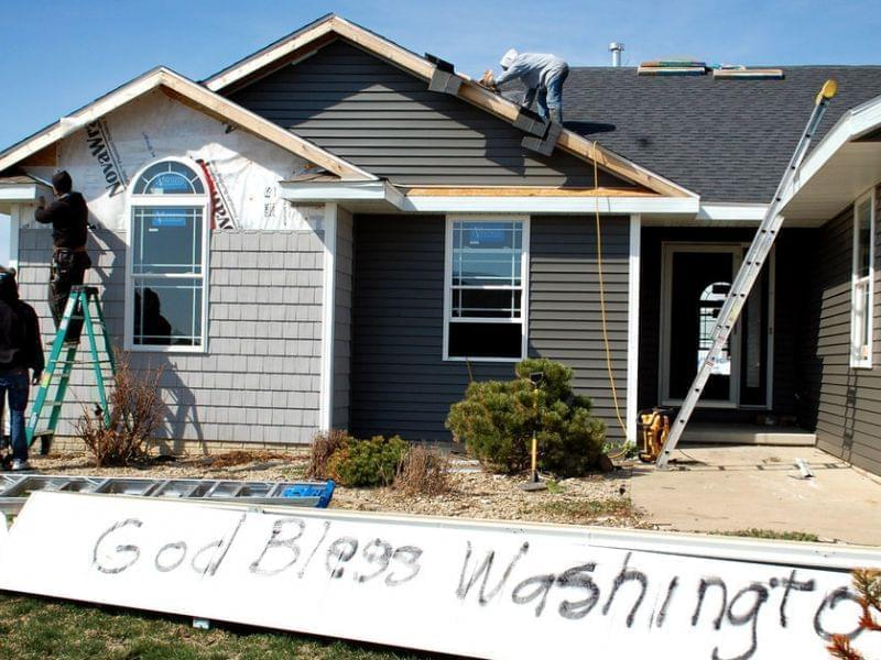 Washington, Ill., is full of both optimistic signs and lots of construction crews as the town rebuilds after a half-mile-wide tornado devastated the area last November.