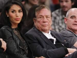 Los Angeles Clippers owner Donald Sterling (center) has been banned by the NBA; he is seen here watching a Clippers game with his girlfriend, V. Stiviano.