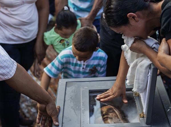 Loved ones express their grief at the burial of Ramon Romero Ramirez in Chichigalpa, Nicaragua, January 2013. The 36-year-old died of chronic kidney disease after working in the sugar cane fields for 12 years. Ramirez is part of a steady procession o