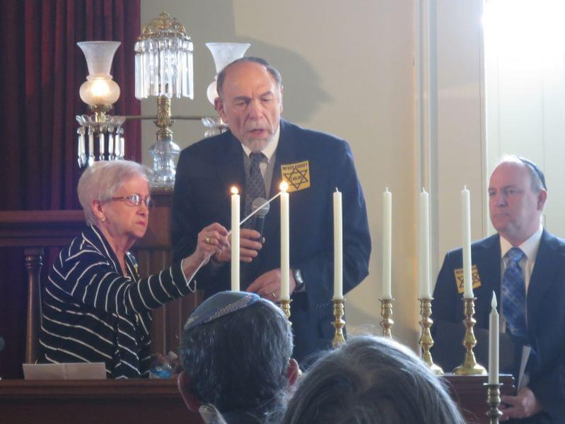 Doris Fogel, left, lit one of six candles at the Holocaust Memorial Ceremony in Springfield. Each candle represents one million Jews killed by the Nazis.