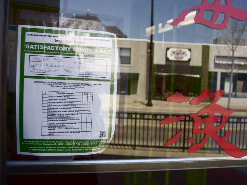 Mandarin Wok's satisfactory compliance placard, 403 1/2 E. Green St., Champaign on Friday, April 25. The restaurant failed its health inspection on March 24 with an adjusted score of 24 and four critical violations but was allowed to correct eno