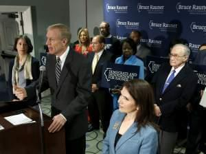 Republican gubernatorial candidate Bruce Rauner, center, responds to questions about the support he is getting from Democrats and Independents as his wife Diana, a Democrat, left, and Lt. Gov. Evelyn Sanguinetti, right, listen during a news conferenc