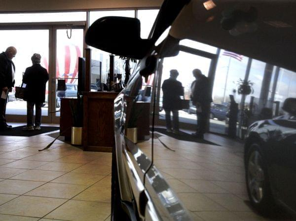 A car salesman speaks with a customer at the Apple Chevrolet dealership in Orland Park, Ill., Saturday, Feb. 28, 2009. Automakers report U.S. sales for February on Tuesday.