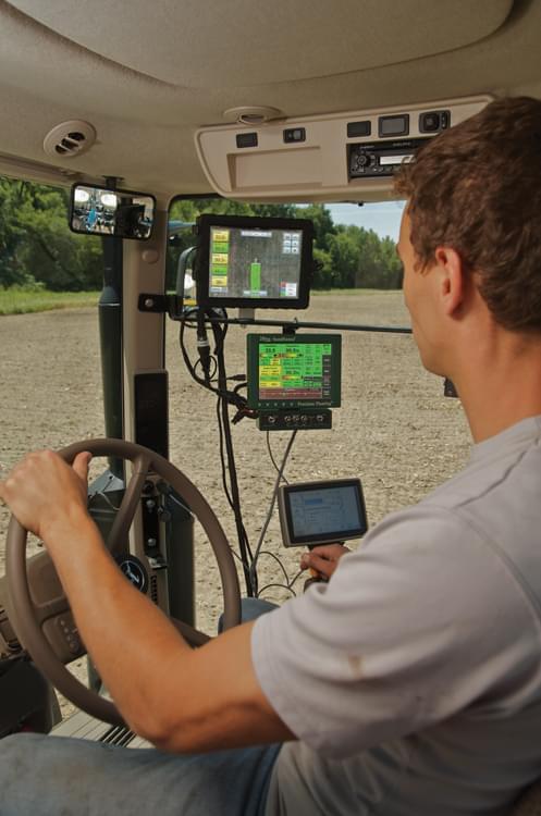 A farmer uses Monsanto's FieldScripts program to plant his field.
