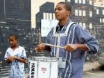Lee drumming outside theater before film screening