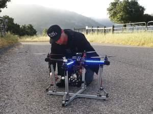 Jeff Blank, of Los Angeles-based Drone Dudes, prepares a quadcopter for takeoff. The drone has to chase a motorcycle down a hill.