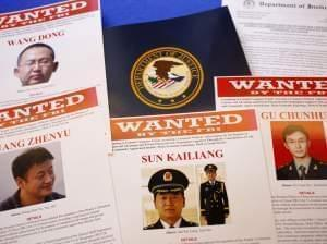 Press materials are displayed on a table of the Justice Department in Washington on Monday, before Attorney General Eric Holder was to speak at a news conference.