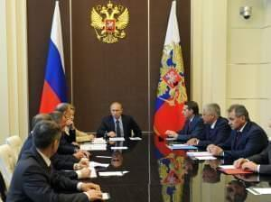 Russia's President Vladimir Putin chairs a Security Council meeting at the Bocharov Ruchei residence in Sochi, on Monday.