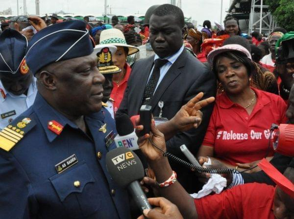 Nigeria's chief of defense staff Air Marshal Alex S. Badeh speaks during a demonstration in Abuja calling for the rescue of girls kidnapped from their school in Chibok. Badeh says the government knows where the girls are — but that a rescu
