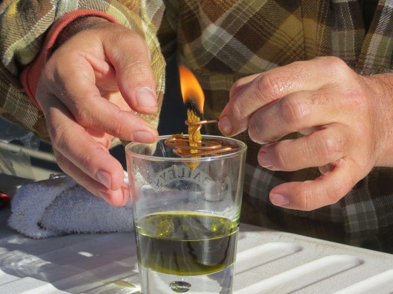 Derek Cross, a chef who specializes in cooking with hemp, demonstrates the burning properties of hemp oil, which he touts as a digestible bio fuel.