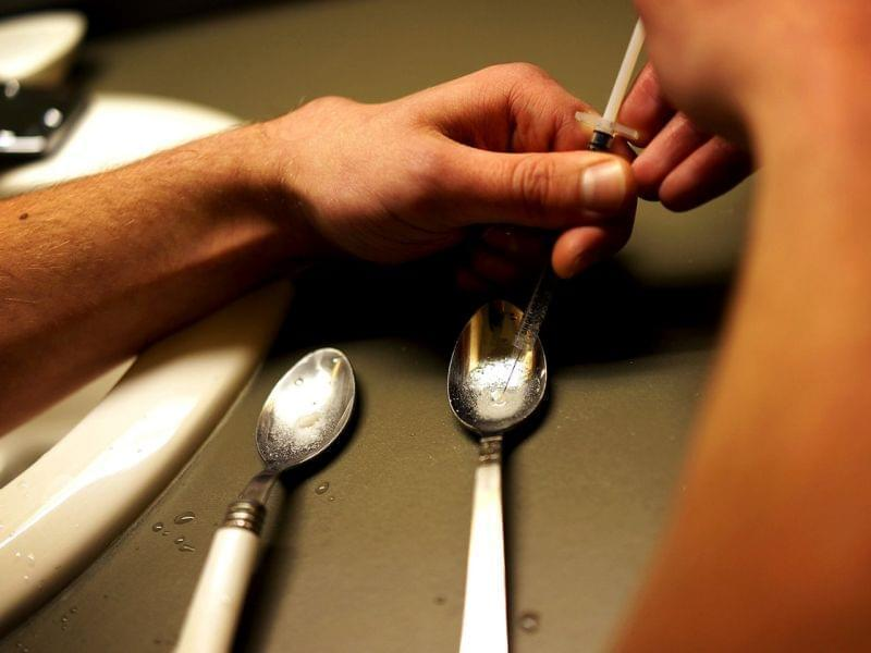 A heroin user in St. Johnsbury, Vt., prepares to shoot up.