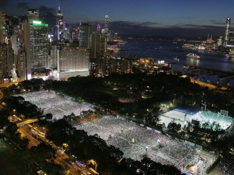 Tens of thousands of people attend a candlelight vigil at Victoria Park in Hong Kong Wednesday to mark the 25th anniversary of the Chinese military crackdown on pro-democracy protests in Beijing.
