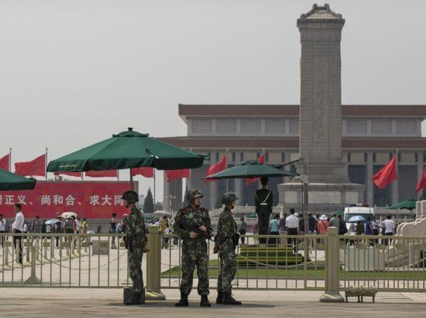 Chinese paramilitary police stand guard in Tiananmen Square in Beijing on June 4, the 25th anniversary of a violent crackdown on protesters by Chinese troops.