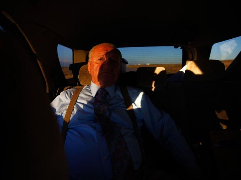 John Huckleberry sits in the back seat of a friend's car on the way back from visiting inmates at Sterling Correctional Facility. After 30 years in prison, Huckleberry — who was released in 2012 — helps aging inmates prepare for life