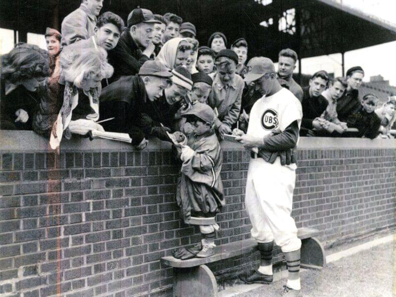 Lennie Merullo signing autographs at Wrigley Field.