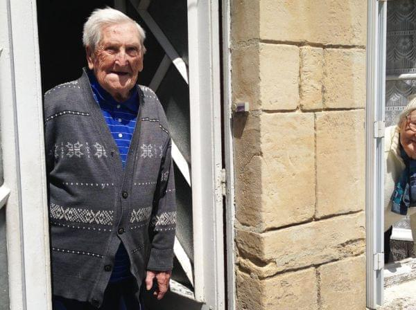 "Lucien (left) and Germaine Rigault lean out of their home in La Cambe, a tiny village in Normandy a short distance from Omaha Beach. The couple, in their 80s, were in La Cambe during the Allied landing on June 6, 1944, and live there still. ""We"