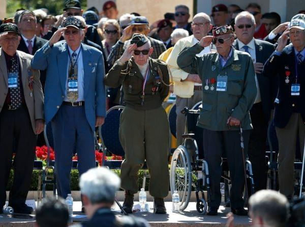 World War II veterans salute as taps is played at a ceremony at the Normandy American Cemetery at Colleville-sur-Mer on Friday, marking the 70th anniversary of D-Day.