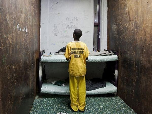 A male juvenile stands in a room at Harrison County Juvenile Detention Center in Biloxi, Miss.
