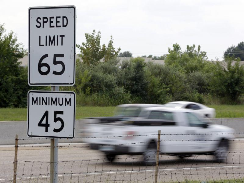 In this Aug. 16, 2013 file photo, vehicles pass a 65 mph speed limit sign along Interstate 64 in O'Fallon, Ill. Illinois Gov. Pat Quinn signed into a law a bill allowing motorists to drive 70 mph on rural interstates.
