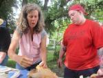 Farmer Kate Potter shows Chef Terrah King how to gut a chicken during Chef Camp on June 8, 2014 in Livingston County, Ill.