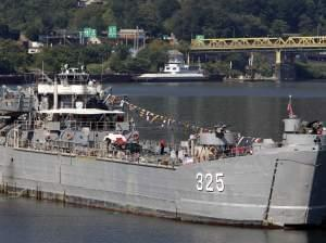 The LST 325, a World War II-era ship that ferried troops to the beaches of Normandy during D-Day, moves up the Allegheny River, preparing to dock in Pittsburgh on Wednesday, Sept. 1, 2010. The craft is crewed by volunteers and veterans who want to te