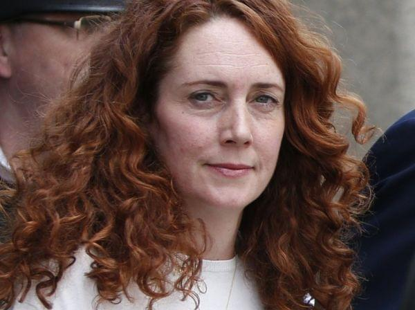 Rebekah Brooks, former News International chief executive, leaves the Central Criminal Court in London Tuesday, after being acquitted. Former News of the World editor Andy Coulson was convicted of phone hacking Tuesday.