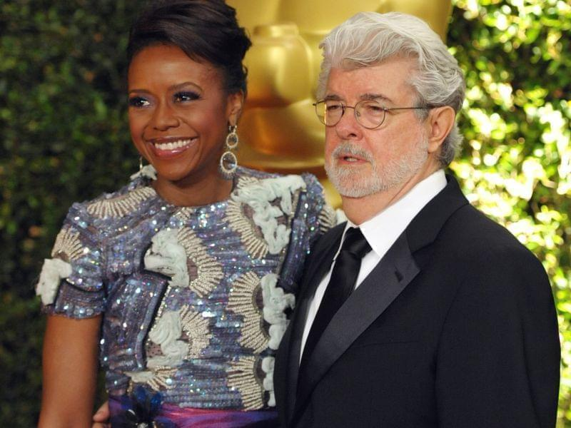 In this Nov. 16, 2013 file photo, filmmaker George Lucas and his wife, Chicago native Mellody Hobson, are seen on the red carpet at the 2013 Governors Awards in Los Angeles.