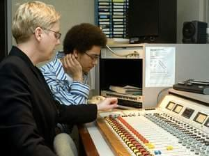 Kimberlie and brian at mixing board at W.I.L.L.