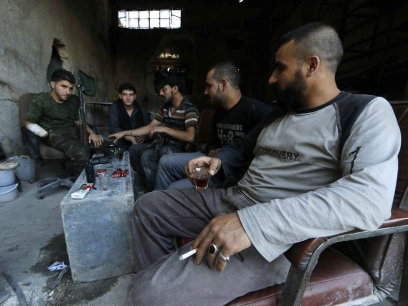 "Rebel fighters drink tea on the front line of Ramouseh, near the Aleppo Artillery School. President Obama has requested $500 million to arm and train ""moderate"" Syrian rebel groups."