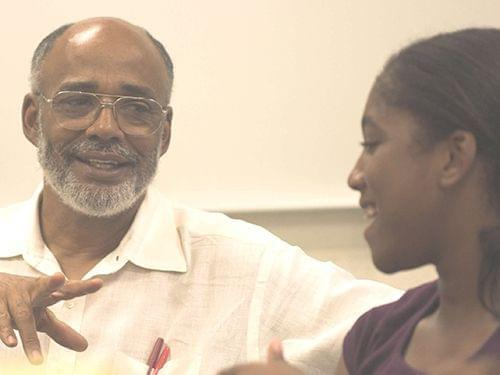 Leon Dash, Swanlund Professor of Journalism at Illinois, and Franklin Middle School student Isis Griffin