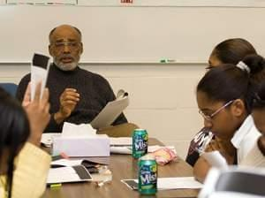 Students read while leon dash instructs