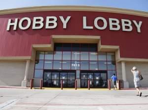 Customers walk into a Hobby Lobby store in Oklahoma City on Monday.