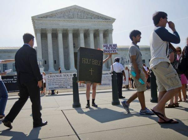 Demonstrator outside the Supreme Court building in Washington, D.C.