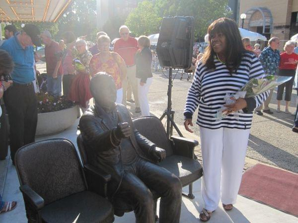 Chaz Ebert with Roger Ebert Sculpture